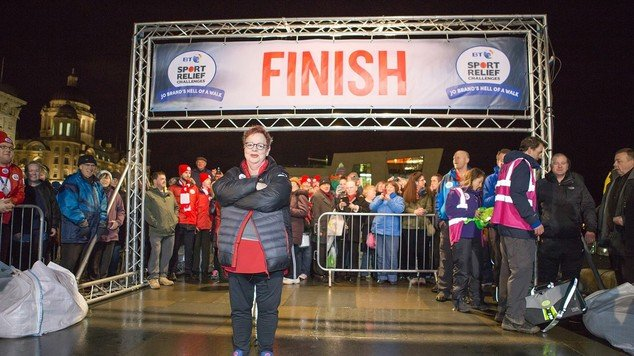 Jo Brand arriving outside the Liver Building to finish her 150 mile walk from Hull to Liverpool for Sport Relief